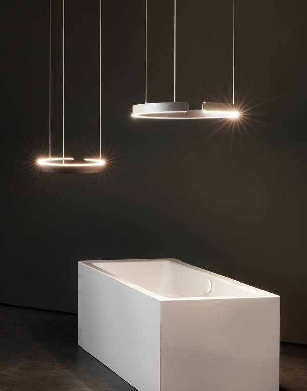 Freestanding Kaldewei Conoduo Meisterstück bathtub with two Mito lamps by Occhio.