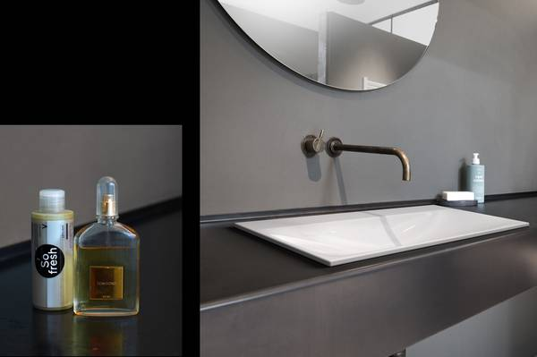 Two photos: Soap dispenser and after-shave bottle on a dark-coloured washbasin with a grey wall / Bathroom design: a white washbasin on a brown vanity unit with a grey wall.